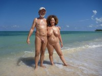 Grandpa with shaved erected cock and grandma with big tits on the beach