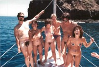 Group of nude people with a lot of saggy tits and hairy pussies and guys with small hairy cocks sailing nude