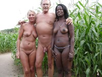 Naked couple showing husband's shaved cut cock and wife's flabby tits and shaved pussy like their black girlfriend with firm tits and hairy cunt