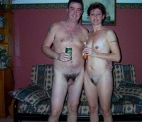 Nude mom and dad posing nude and showing mom's big trimmed cunt and tiny tits and dad with small shaved cock