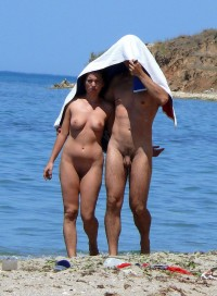 Nudist couple showing boy's tiny hairy uncut dick a girl's firm tits and shaved cunt covering themselves with towel