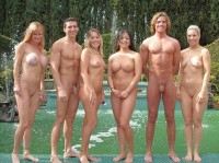 Nudist group posing for a nude photo with their big shaved cocks and girls with huge firm tits and shaved pussies