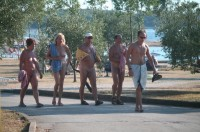 Nudist group walking along the beach with guys with tiny little shaved dicks and women with big flabby tits and shaved cunts