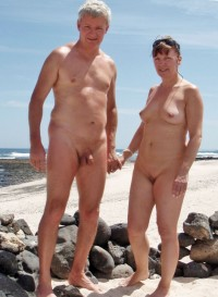 Older couple on a beach showing guy's small shaved uncut cock and woman's firm tits and shaved cunt