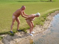 Older couple playing nude beside a river and showing older woman with floppy tits and shaved cunt and guy with tiny uncut cock