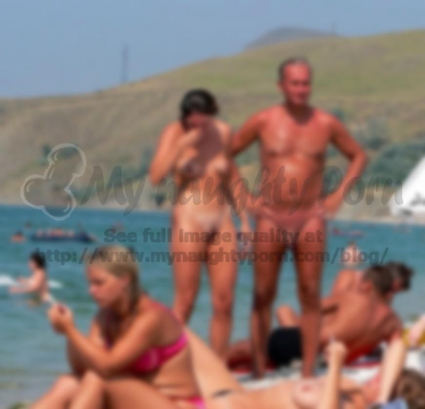 Cock nude beach couple big