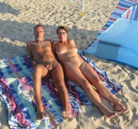 Older nudist couple on a sand beach showing guys small shaved uncut dick and woman's huge saggy tits and shaved cunt