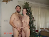 Our christmas family photo showing my cut hairy dick and my mistress with tiny tits and trimmed vagina