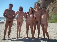 Some nude friends on a beach with girls with huge flabby tits and hairy and trimmed cunts and guy's with small uncut dicks
