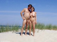 Some stranger with semi-hard thick shaved penis on a nude beach posing with my big flabby breasts and trimmed vagina