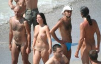 Walking nude on a beach with my tiny little hairy uncut cock and my girlfriend with big saggy tits and small shaved pussy