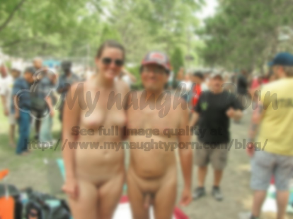 young girl at a nudist festival with firm tits and shaved cunt