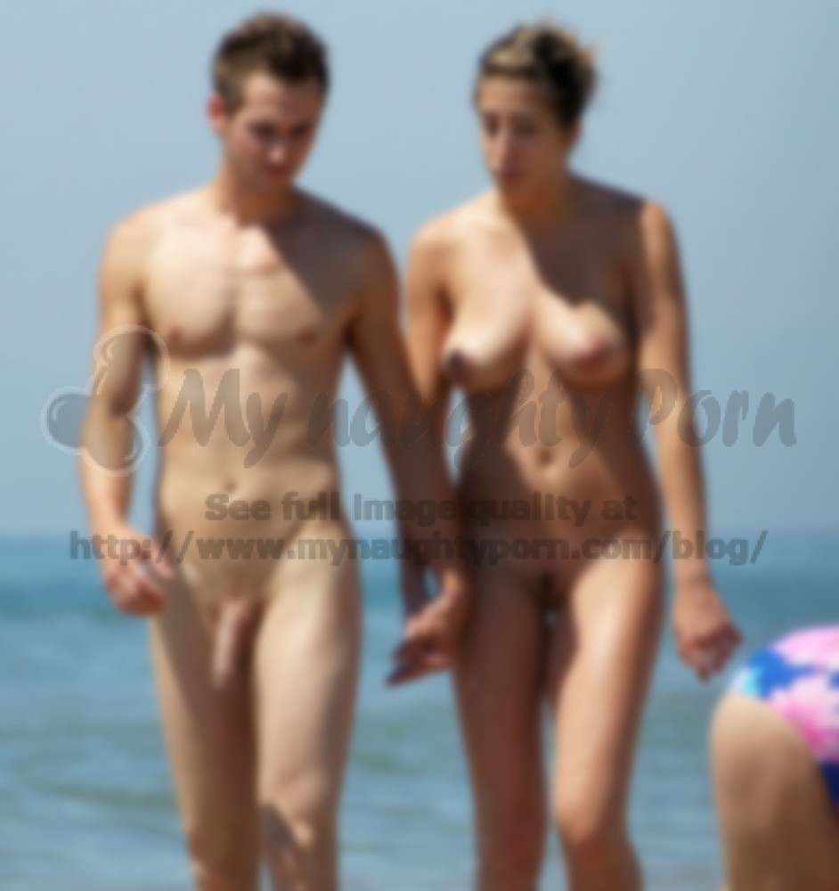older couple on a beach posing nude with woman's big hairy cunt and