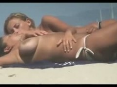 big boobed lesbians voyeured on the beach