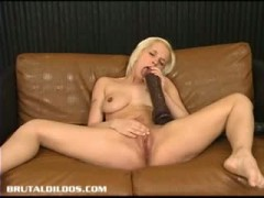 Blonde stretching her pussy with a brutal dildo